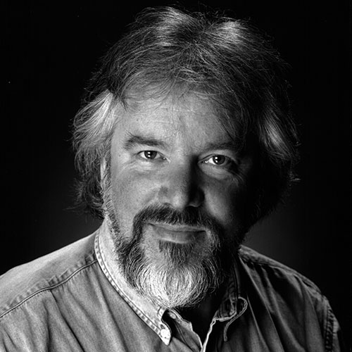 Headshot of Sir John Tomlinson