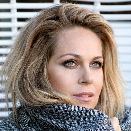 Headshot of Kristine Opolais